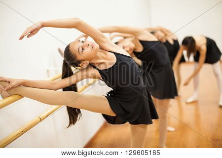 Girls With Their Leg Up During Ballet Class