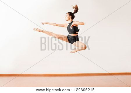Dancer Doing A Leg Split In The Air