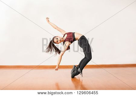 Young Hispanic Dancer Standing On Her Toes