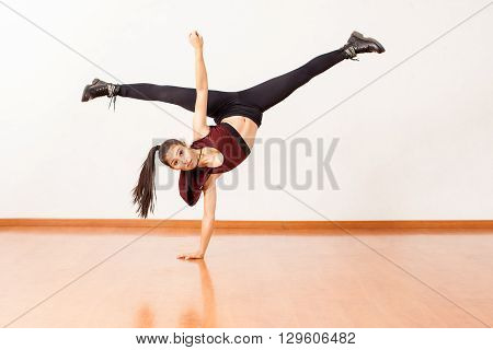 Hispanic Dancer Doing A Handstand And Leg Split