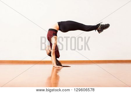Dancer Doing Handstand And Arching Her Back