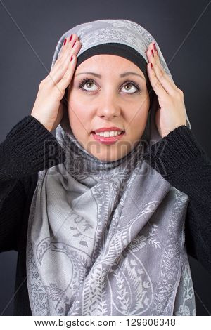 Muslim Woman Adjusting Her Headscarf
