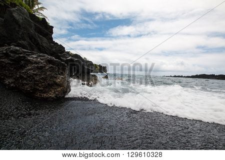 Waves Crashing On Black Sand Beach