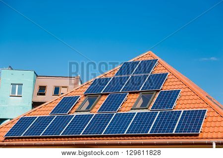 Solar panels on the red roof of a building