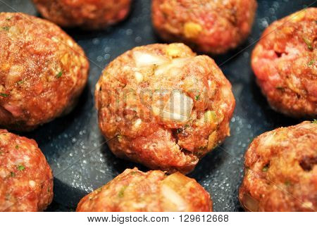 Many Raw Meatballs Ready to be Baked