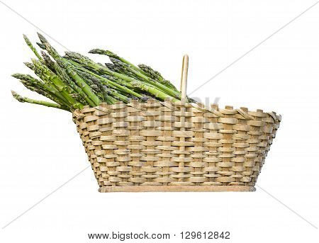 Healthy asparagus in a basket isolated on white.