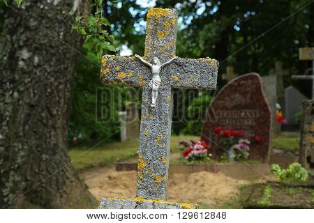 concrete cross with a crucifix in the cemetery