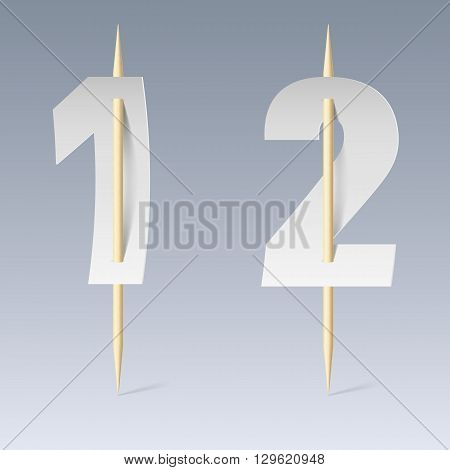 Illustration of white paper cut font on toothpicks on grey background. 1 and 2 numerals