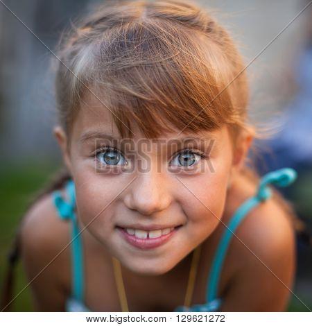 Closeup portrait of a playful cute little girl.