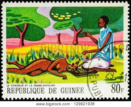 MOSCOW RUSSIA - MAY 12 2016: A stamp printed in Guinea shows black man and antelope woman series