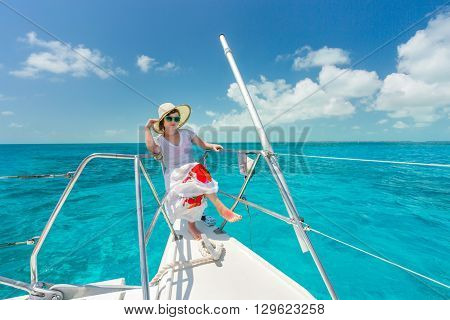 Beautiful woman relaxing on saiboat in middle of the caribbean sea