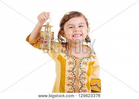 Ramadan Kareem - Happy young girl celebrating Ramadan with her lantern