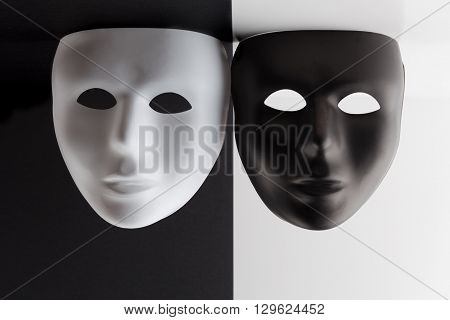 Black And White Masks Hanigng From The Ceiling