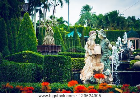 Pattaya,thailand - March 18,2016: Sculpture Girl And Boy Of Stone By The Fountain In A Tropical Park