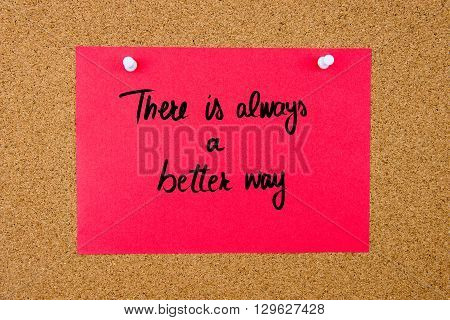 Red Paper Note With Handwritten Text On Cork Board