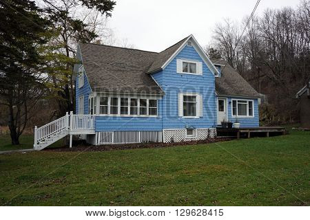 HARBOR SPRINGS, MICHIGAN / UNITED STATES - DECEMBER 23, 2015: A blue home on Fourth Street in Harbor Springs.