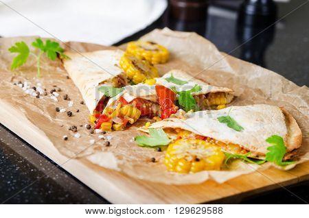vegan burrito with avocado, tomato and corn