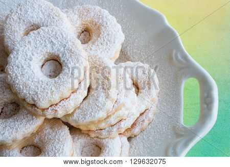 Closeup of Linzer cookies lying on a vintage plate