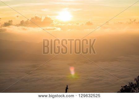 Sunrise on spectacular mountains white cloud with fog