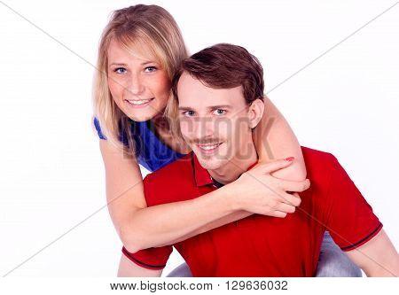 Man giving his pretty girlfriend a piggy back ride