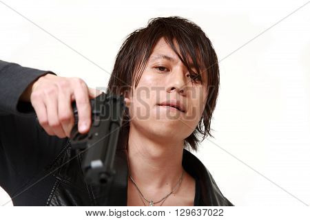 portrait of studio shot of a man with a handgun on white background