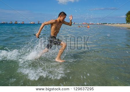 Labuan,Malaysia-April 30, 2016:The Cross Channel Swimming Outdoor 2016 athlete in action at Labuan International Sea Sports Complex at Labuan,Malaysia on 30th April 2016.