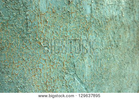 Cracked plaster texture. Old green plastering pattern