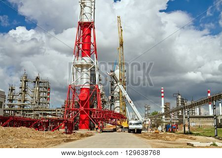 Unloading Sections Of The Boom Of A Large Crawler Crane Using A Crane On Site Of A Petrochemical Pla