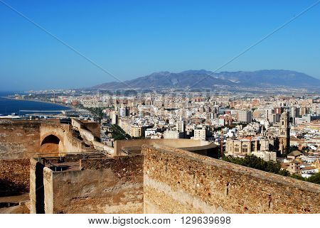 MALAGA, SPAIN - JULY 11, 2008 - Gibralfaro castle walls with views over the city and coastline Malaga Malaga Province Andalucia Spain Western Europe, July 11, 2008.