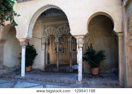 MALAGA, SPAIN - JULY 11, 2008 - Ornate entrance arches in the Nasrid Palace Malaga castle (Alcazaba de Malaga) Malaga Malaga Province Andalucia Spain Western Europe, July 11, 2008.