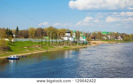 View of the ancient Mirozhsky monastery on the banks of the Velikaya River in Pskov