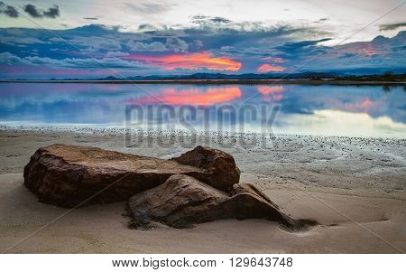Stones on the beach and dramatic sky background