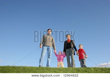 family of four on grass