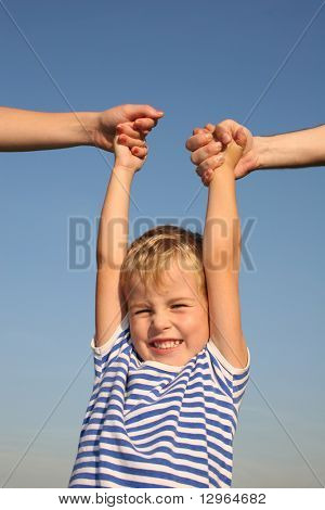 boy with parents hands