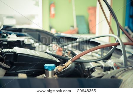 Car refilling air condition in air shop process in vintage style