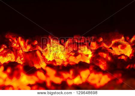 bright burning coals close-up on dark background