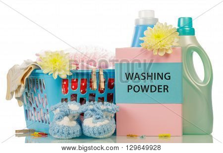 Laundry detergent and a basket of linen isolated on white background