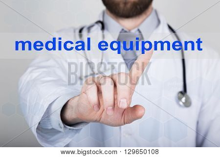 technology, internet and networking in medicine concept - medical doctor presses medical equipment button on virtual screens. Internet technologies in medicine.