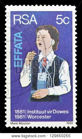 SOUTH AFRICA - CIRCA 1981 : Cancelled postage stamp printed by South Africa, that shows Deaf girl learning to speak.