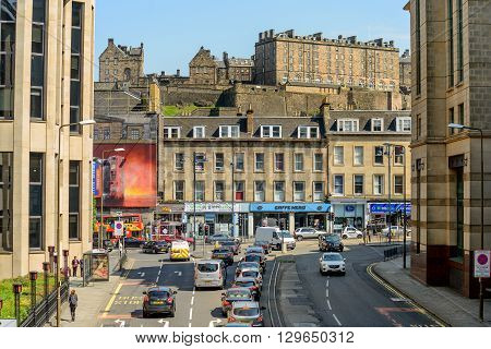 EDINBURGH SCOTLAND - MAY 10 2016: West Approach Road junction with Lothian Road. Edinburgh Castle in the background.