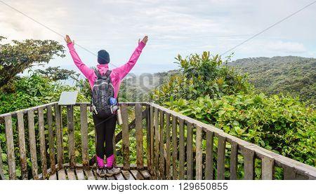 Female Hiker Raising Hands