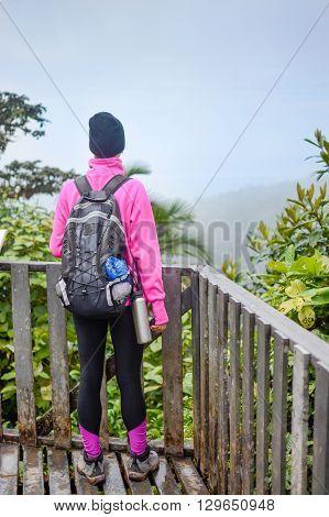 Mountaineer Girlon A Wooden Terace