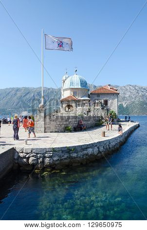 PERAST MONTENEGRO - SEPTEMBER 16 2015: Unknown tourists visit the Island of Our Lady on the Reef near the resort town Perast in the Bay of Kotor Montenegro
