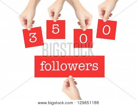 3500 followers written on cards held by hands