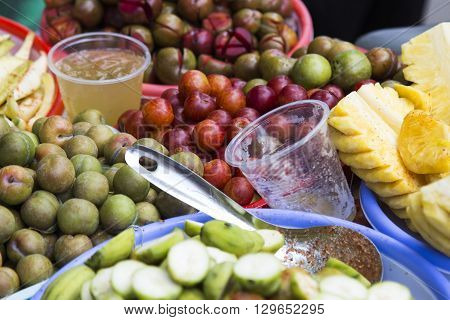 Fresh tropical fruits for sale by vendor