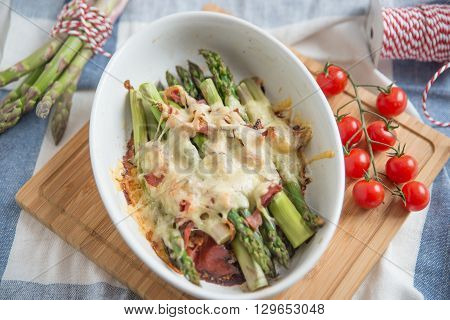 Vegetable gratin with asparagus, cheese and bacon