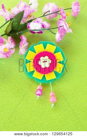 Felt brooch flower. Bright accessory for girls