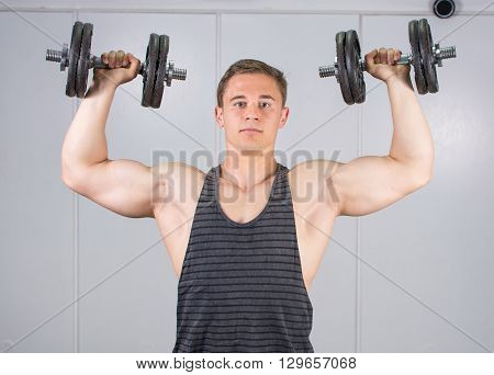 Man Performing Shoulder Workout At The Gym