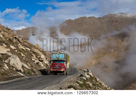 LADAKH INDIA - SEPTEMBER 07 2014: Truck on the high altitude Manali-Leh road in Lahaul valley state of Himachal Pradesh Indian Himalayas India