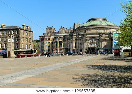 EDINBURGH SCOTLAND - MAY 10 2016: The Usher Hall in Edinburgh with Edinburgh Castle behind.